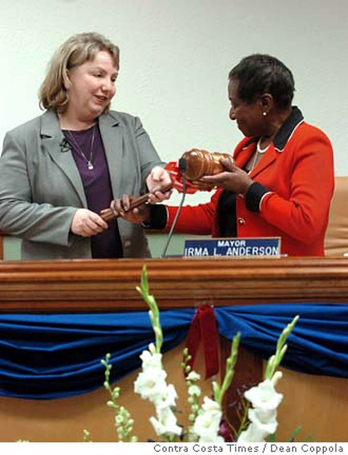 Mayor-elect Gayle McLaughlin, left, is handed a ceremonial gavel by outgoing Mayor Irma Anderson during swearing-in ceremonies at Richmond City Hall in Richmond, Calif. on Tuesday, Jan. 09, 2007. (AP Photo/Contra Costa Times, Dean Coppola) ** NO MAGS, , NO INTERNET, NO TV **