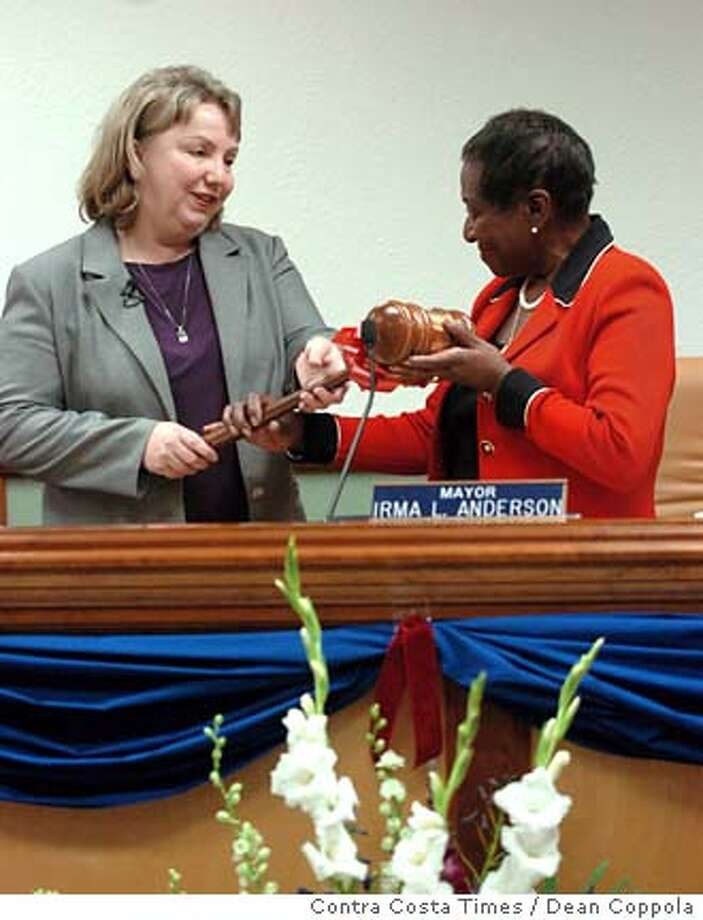 Mayor-elect Gayle McLaughlin, left, is handed a ceremonial gavel by outgoing Mayor Irma Anderson during swearing-in ceremonies at Richmond City Hall in Richmond, Calif. on Tuesday, Jan. 09, 2007. (AP Photo/Contra Costa Times, Dean Coppola) ** NO MAGS, , NO INTERNET, NO TV ** Photo: Dean Coppola