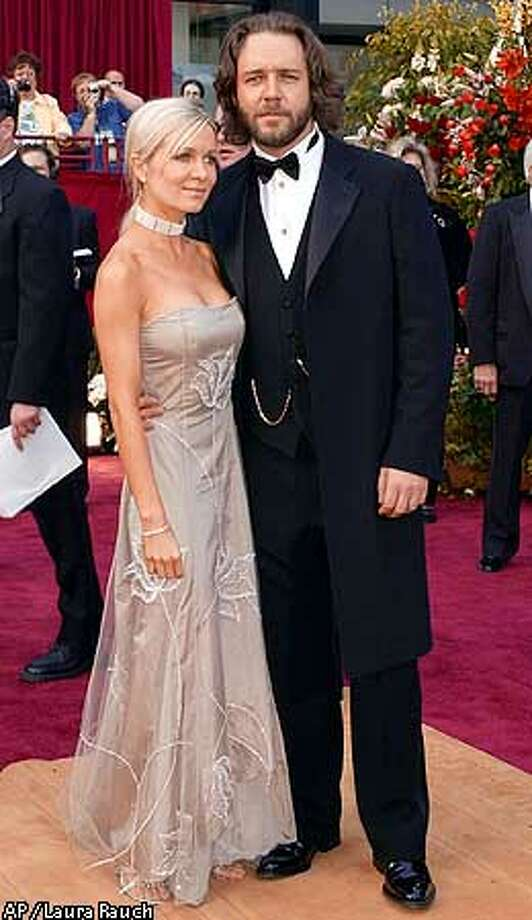 Australian actor Russell Crowe arrives with companion Danielle Spencer, for the 74th annual Academy Awards on Sunday, March 24, 2002, in Los Angeles. Crowe is nominated for Best Actor for his role in A Beautiful Mind. (AP Photo/Laura Rauch) Photo: LAURA RAUCH