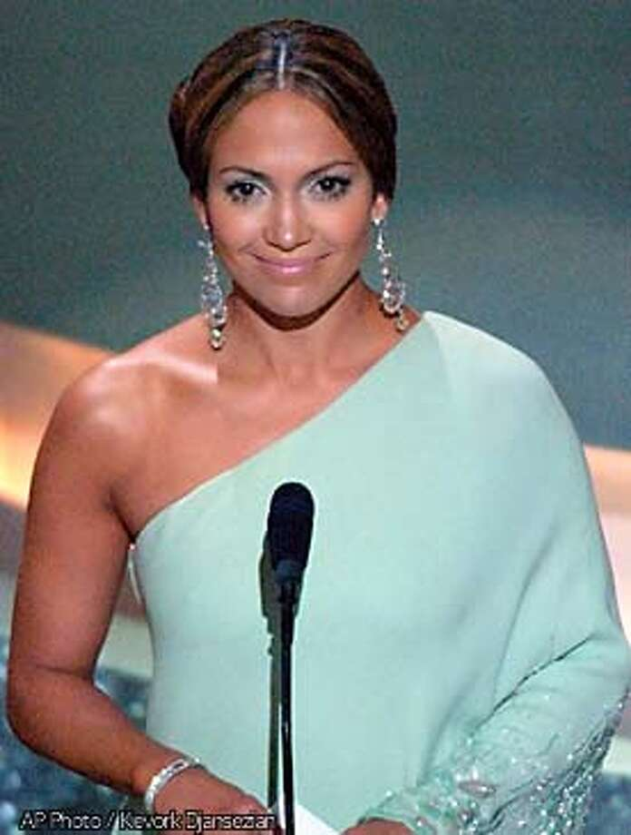 **EMBARGOED AT THE REQUEST OF THE MOTION PICTURE ACADEMY FOR USE UPON CONCLUSION OF ACADEMY AWARDS TELECAST** Actress Jennifer Lopez presents the award for art direction at the 75th annual Academy Awards on Sunday, March 23, 2003, in Los Angeles. (AP Photo/Kevork Djansezian) Photo: KEVORK DJANSEZIAN