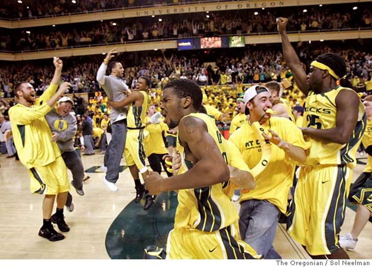 Oregon's Aaron Brooks, front center, runs around mid-court as Oregon players and fans celebrate after No. 16 Oregon beat No. 1 UCLA 68-66 in a basketball game Saturday, Jan. 6. 2007, at McArthur Court in Eugene, Ore. (AP Photo/The Oregonian, Sol Neelman) ** MAGS OUT ** MAGS OUT EFE OUT