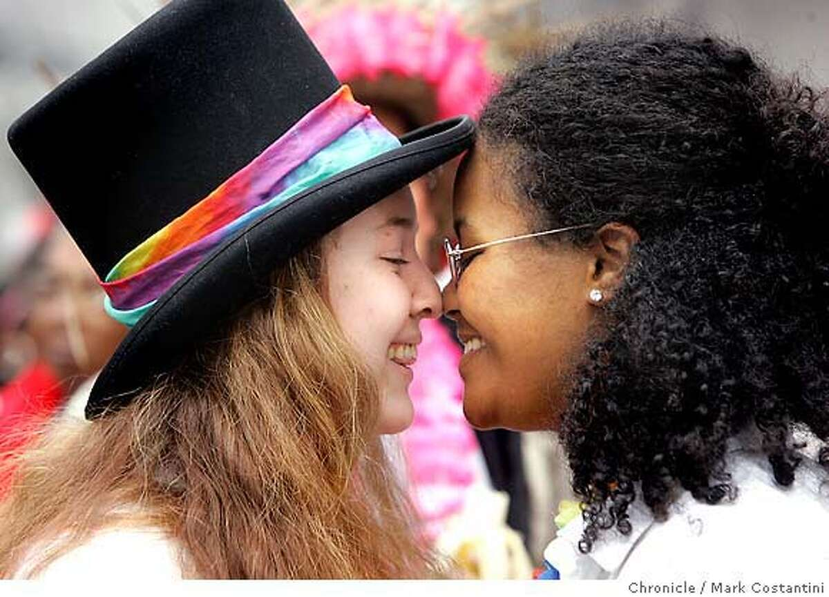 (L-R) Juliette Capra and Ashlyn Adamsof Berkeley share a moment at the parade. Spectators at the the Pride 2005 Gay pride parade. Photograph by Mark Costantini/S.F. Chronicle. Juliette Capra and Ashlyn Adams of Berkeley share a moment at the Gay Pride Parade on Sunday, June 26, 2005, in San Francisco. Chronicle photo by Mark Costantini