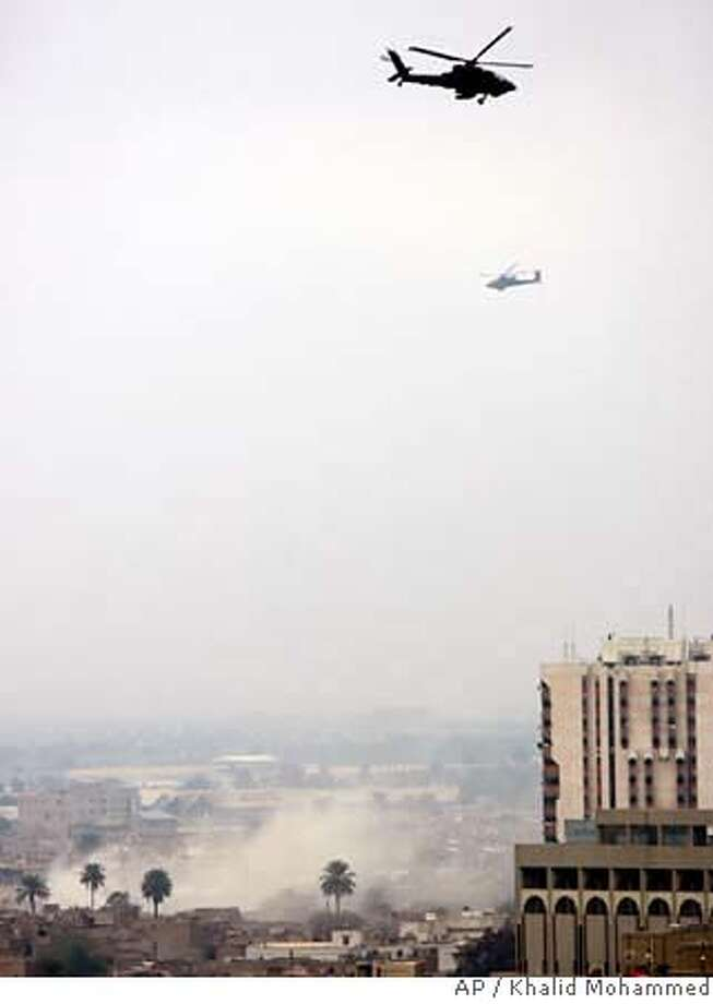 U.S. military Apache helicopters fly as smoke rises over Baghdad's Haifa Street area, Iraq, Tuesday, Jan. 9, 2007. Iraqi soldiers backed by U.S. troops battled gunmen in central Baghdad Tuesday, and explosions were heard in the area, police, witnesses and the U.S. military said. (AP Photo/Khalid Mohammed ) Photo: KHALID MOHAMMED