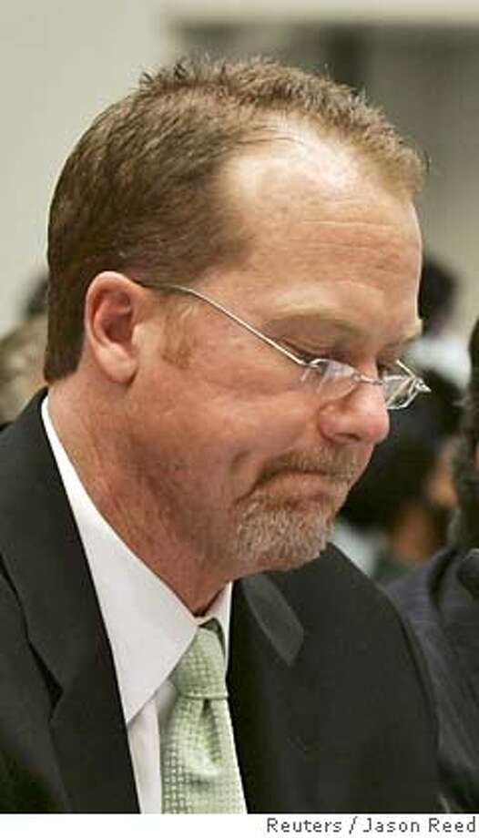 Former St. Louis Cardinals star Mark McGwire pauses as he reads a prepared statement after being sworn in to testify at the House of Representatives hearing on Government Reform in Washington in this March 17, 2005 file photo. McGwire failed to be inducted into the Baseball Hall of Fame, while Tony Gwynn and Cal Ripken Jr. were named as 2007 inductees on January 9, 2007. REUTERS/Jason Reed/Files (UNITED STATES) Photo: JASON REED