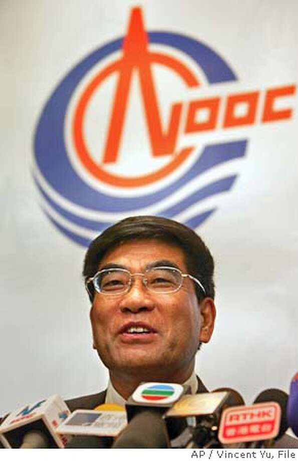 **FILE** In a file photo Chairman and Cheif Executive officer of China National Offshore Oil Corporation ( CNOOC ) Fu Chengyu smiles as he speaks to reporters during a press conference in Hong Kong Tuesday, March 29, 2005. Unocal Corp. is weighing a $16.6 billion offer from Chevron Corp. that received quick regulatory approval and a rival $18.5 billion all-cash bid from Hong Kong-based CNOOC Ltd. that has become highly politicized over concerns about national security and U.S.-China trade relations. (AP Photo/Vincent Yu, file) Photo: VINCENT YU