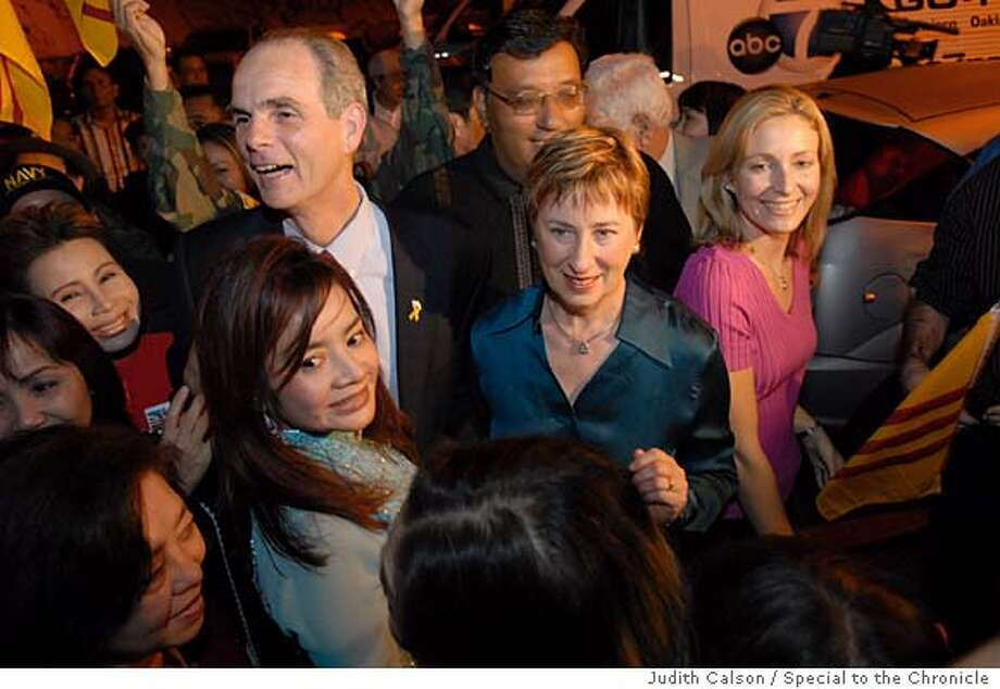 Chuck Reed, district 4 City Councilmember, running for Mayor of San Jose on Tuesday, November 7, 2006. Chuck, his wife Paula and daughter (blond) Kim Campbell are greeted by a group of Vietnamese supporters. Ran on: 01-10-2007  Chuck Reed, shown with his wife, Paula (center), and daughter, Kim (right), on election day, made his swearing-in a family affair.  Ran on: 01-10-2007 Ran on: 01-10-2007  Chuck Reed, shown with his wife, Paula (center), and daughter, Kim (right), on election day, made his swearing-in a family affair. Photo: Judith Calson