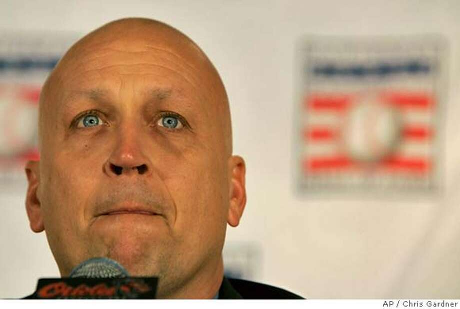 Former Baltimore Orioles shortstop Cal Ripken reacts as he answers a question about his father as he speaks to reporters during a news conference after being voted into the Baseball Hall of Fame Tuesday, Jan. 9, 2007 in Baltimore.(AP Photo/Chris Gardner) Photo: Chris Gardner