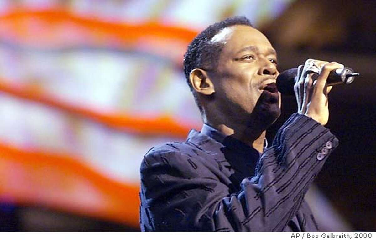 ** ADVANCE FOR Wednesday, FEB. 4--FILE **Singer Luther Vandross entertains the crowd at the Democratic National Convention in Los Angeles, in this Aug. 15, 2000, file photo. Vandross is nominated under the category of song of the year in this year's Grammy Awards, being held Feb. 8 in Los Angeles. (AP Photo/Bob Galbraith/FILE) Luther Vandross was nominated for five Grammy awards, including song of the year. He suffered a stroke in April. ProductNameChronicle ProductNameChronicle