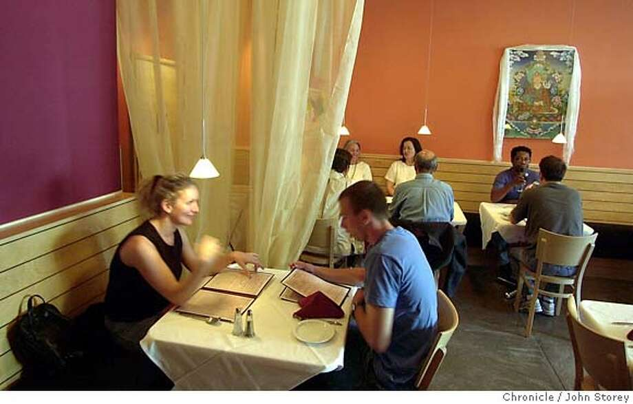 dining813074_jrs.jpg  Restaurant review Little Nepal Restaurant in San Francisco. 8/5/03 in San Francisco. JOHN STOREY / The Chronicle MANDATORY CREDIT FOR PHOTOG AND SF CHRONICLE/ -MAGS OUT  Ran on: 01-10-2007  High ceilings, light wood paneling and snazzy wall colors help make Little Nepal an enjoyable spot to eat. Photo: JOHN STOREY