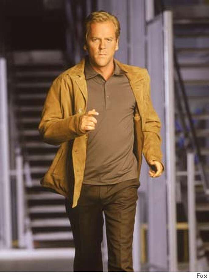 �CARMAN20-19SEP01-DD-HO This precedent-setting television series takes place over a 24 hour day, from midnight to midnight, with each episode covering one hour in the life of the characters told in real time. Jack Bauer (Kiefer Sutherland, pictured) is the head of an elite team of CIA agents with only 24 hours to uncover an assasination plot against the Presidental candidate David Palmer (Dennis Haysbert.) 2001FOX BROADCASTING CR:FOXRan on: 04-15-2006 Popular Fox shows like &quo;24,&quo; starring Kiefer Sutherland, will soon be available online. CAT Photo: ?