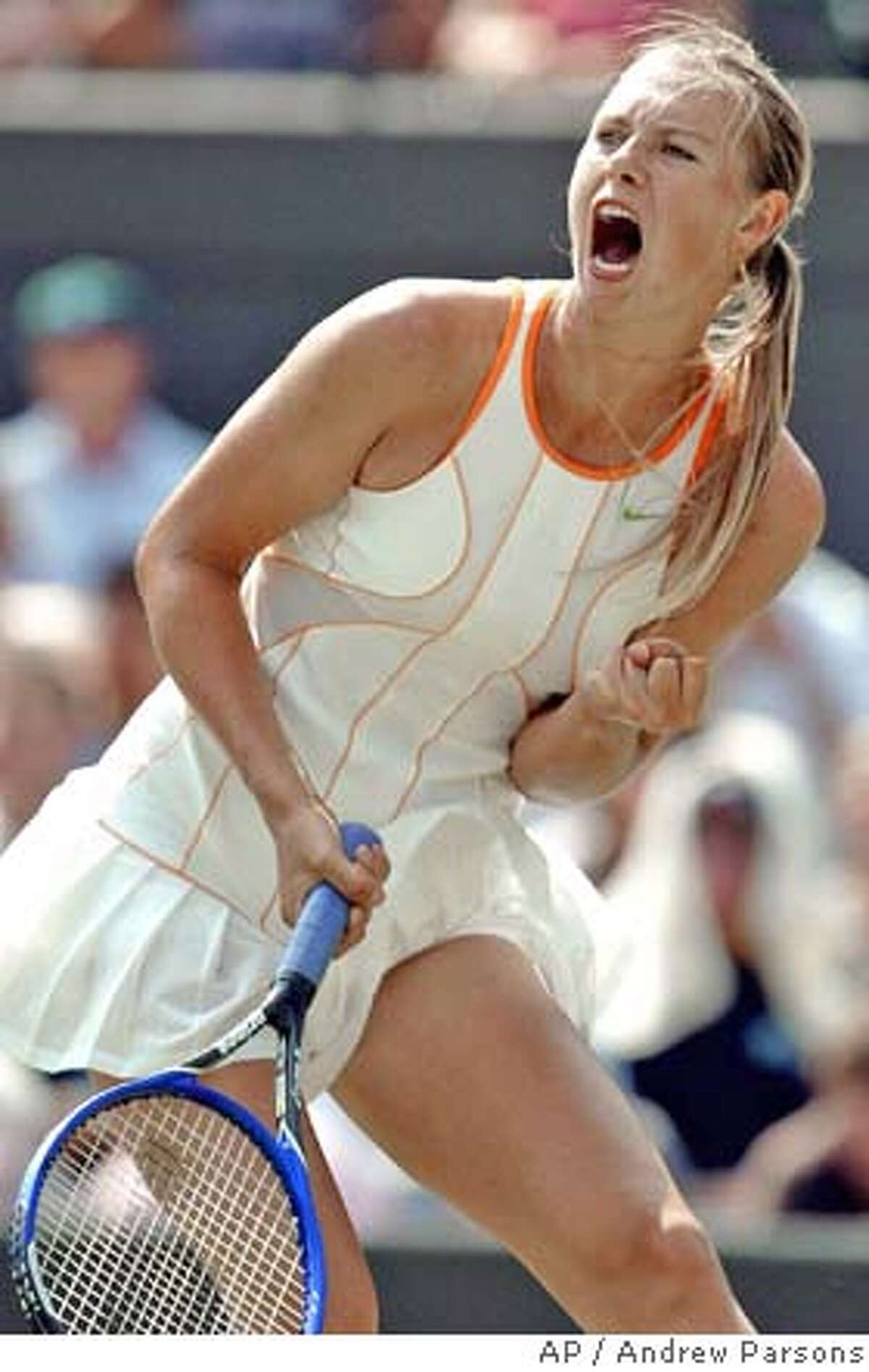 Russia's Maria Sharapova reacts after winning a point against France's Nathalie Dechy during her Women's Singles fourth round match at Wimbledon, England , Monday June 27, 2005. Sharapova won the match 6-4, 6-2. (AP Photo Andrew Parsons/PA) ** UNITED KINGDOM OUT EDITORIAL USE ONLY NO MOBILE PHONE USE **
