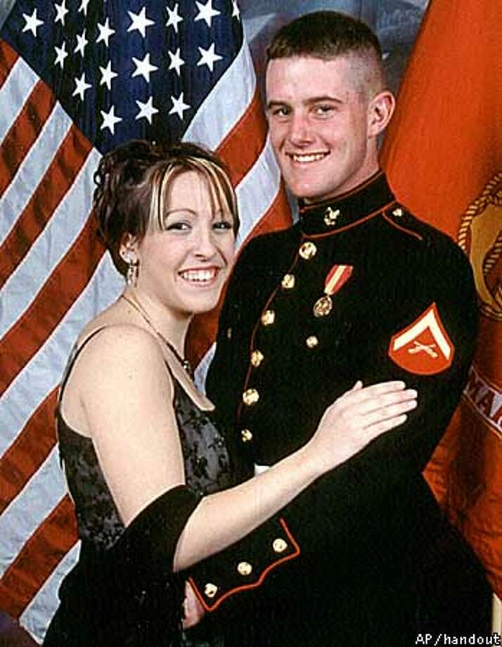 This is an undated family photo of Lance Cpl. Patrick O'Day and his wife Shauna. O'Day, 20, was killed last week when his tank plunged off a bridge into the Euphrates River in Iraq. It was dark, and with a heavy sandstorm, there were no witnesses, his father said. (AP Photo/O'Day family handout, via the Santa Rosa Press Democrat)