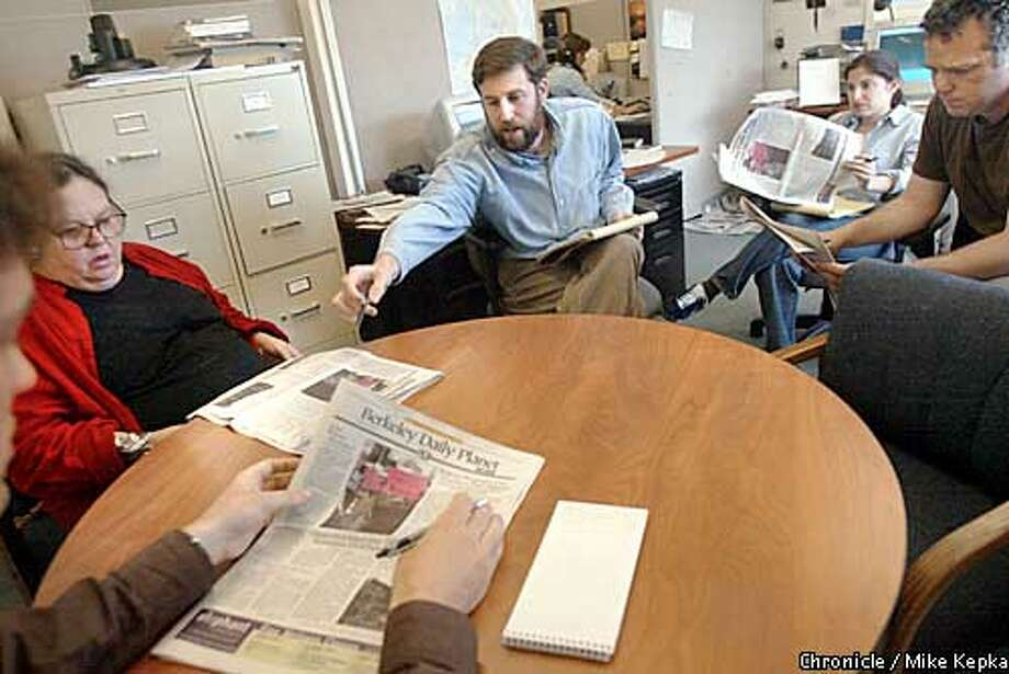 Berkeley Daily Planet managing editor, Michael Howerton, critique the first printing of the paper since it recently changed hands. BY MIKE KEPKA/THE CHRONICLE Photo: MIKE KEPKA