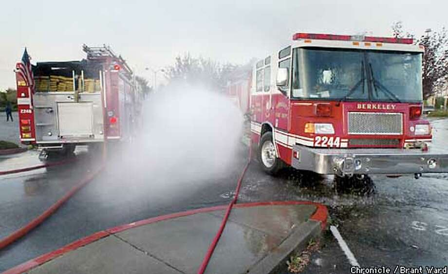 As part of an early morning BART drill, Berkeley fire engines emit a fine spray of water between two trucks which contaminated personnel could pass through to help clean themselves off in a chemical attack. By Brant Ward/Chronicle Photo: BRANT WARD