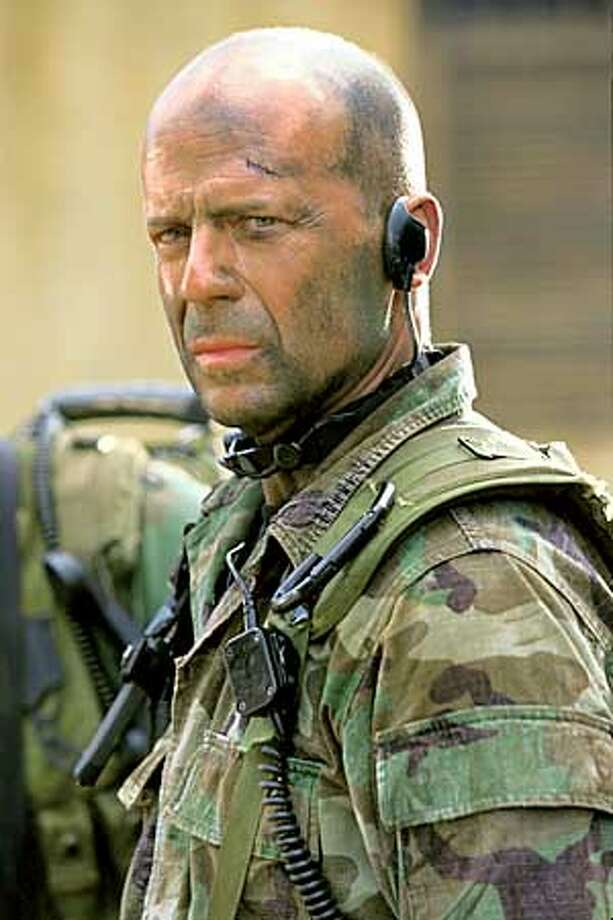 """THIS IS A HANDOUT IMAGE. PLEASE VERIFY RIGHTS. Bruce Willis stars as Navy SEAL Lieutenant A.K. Waters in Revolution Studios� exciting action adventure """"Tears of the Sun,"""" a Columbia Pictures release. Photo: Frank Masi"""