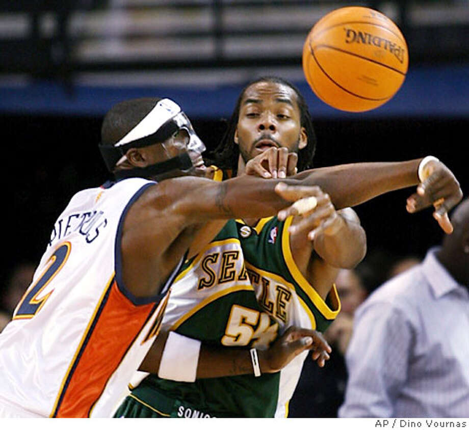 Golden State Warriors' Mickael Pietrus, of France, tries to stop a pass by Seattle SuperSonics' Chris Wilcox in the first quarter of an NBA basketball game Saturday, Jan. 6, 2007, in Oakland, Calif. (AP Photo/Dino Vournas) Photo: Dino Vournas