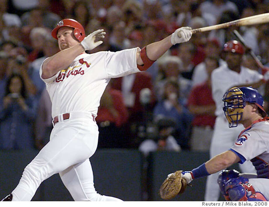 STL03D:SPORT-BASEBALL:ST. LOUIS,8SEP98 - St. Louis Cardinals Mark McGwire watches the ball clear the left field fence as he hits his record breaking 62nd home run in front of Chicago Cubs catcher Scott Servais in the fourth inning of their game September 8. McGwire broke the record held by Roger Maris. gmh/Photo by Mike Blake REUTERS Mark McGwire used androstenedione during the 1998 season, when he hit his record-breaking 62nd home run and eight more. Ran on: 03-09-2005  Jose Canseco Ran on: 03-09-2005  Jose Canseco  Ran on: 01-07-2007  NO Mark McGwire needs to come clean. Voting for him would endorse his empty promise to help kids and other players to stay off steroids. Photo: MIKE BLAKE