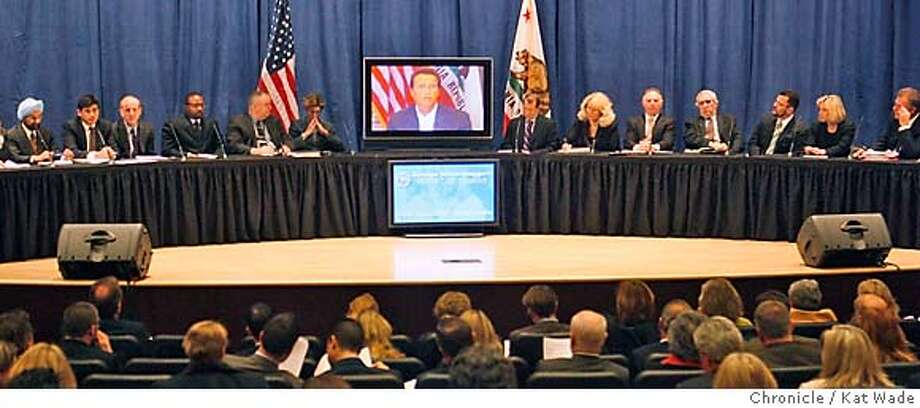 GOV_HEALTHCARE_0197_KW_.jpg  (L to R) A panel including a variety of people with a vested interest in the California Health Care System Robert K. Ross, M.D., president and CEO of The California Endowment, Steven A. Burd Chairman and CEO Safeway Inc., Peter Harbage, Senior Associate, health program of the New America Foundation, Anmol Singh Mahal, M.D., president of the California Medical Association, Anthony Wright, executive director of Health Access California, Jay M. Gellert, president and CEO of Health Net, Inc., Tyrone Freeman president of local 6434, United Long Term Care Workers, John Ramey, the Governor's Senior Health Policy Consultant, Kim Belsh�, Secretary of California Health and Human Services Agency, Governor Arnold Schwarzenegger (on screne VIA SATELITE due to his broken leg and restrictions on traveling, Herb Schultz, the Governor's Senior Health Policy advisor, Connie Conway, Tulare County Supervisor, Allan Zaremberg, president and CEO of the California Chamber of Commerce, Joel Fox president of Small Business Action Committee, Hector Ramirez, chair First 5 California Commission, Gloria L. Austin, CEO of Brown & Toland, Scott Hauge, president and founder of Small Business California and Andrew B. Leeka, president and CEO of Good Samaritan Hospital in Los Angeles listen as the Governor announces his health care reforms plans via satelite at the California Department of Health Services auditorium in Sacramento Monday January 7, 2007. Kat Wade/The Chronicle Mandatory Credit for San Francisco Chronicle and photographer, Kat Wade, Mags out Photo: Kat Wade
