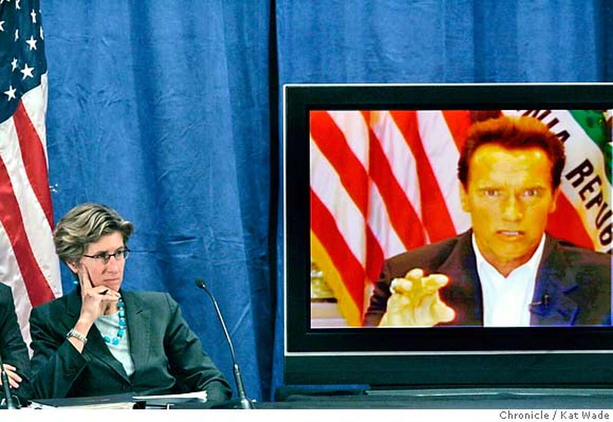 GOV_HEALTHCARE_0066_KW_.jpg Governor Arnold Schwarzenegger (RIGHT) (VIA SATELITE due to his broken leg and restrictions on traveling) announces his health care reforms plans while Kim Belshe, (LEFT) Secretary California Health and Human Services Agency, listens before detailing the governor's plan with a panel of speakers at the California Department of Health Services auditorium in Sacramento Monday January 7, 2007. Kat Wade/The Chronicle Mandatory Credit for San Francisco Chronicle and photographer, Kat Wade, Mags out