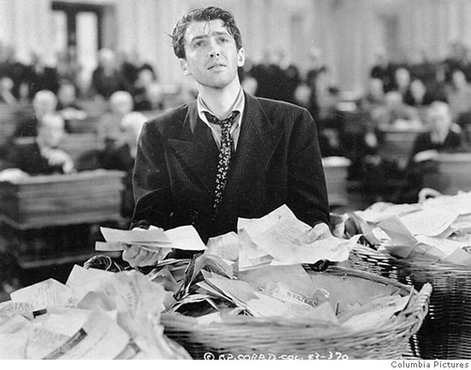 "FILE--James Stewart is shown in a scene from the 1939 film ""Mr. Smith Goes to Washington"". Hollywood columnist Army Archerd reported the actor died Wednesday, July 2, 1997 at his home in Beverly Hills, Ca. He was 89. Frank Capra, who directed ``Mr. Smith'' and ``It's a Wonderful Life,'' once said that even better than a great performance was ``a level of no acting at all, when the actor disappears and a real live person appears on the screen, a person the audience cares about immediately.'' Stewart wasone of the few to reach that level, Capra said. (AP Photo/File) Ran on: 10-27-2004  1933 Walter Huston becomes a crusading president in &quo;Gabriel Over the White House.&quo; CAT Photo: Columbia Pictures"
