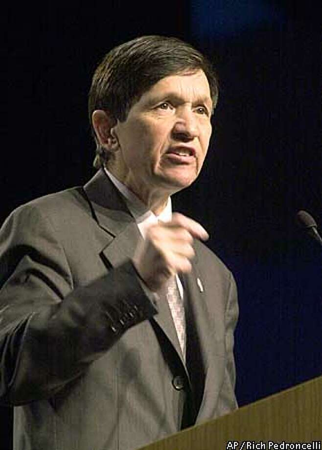 Democratic presidential candidate, Rep. Dennis Kucinich, D-Ohio, gestures while speaking at the California Democratic Party State Convention held in Sacramento, Calif., Sunday, March 16, 2003.(AP Photo/Rich Pedroncelli) Photo: RICH PEDRONCELLI