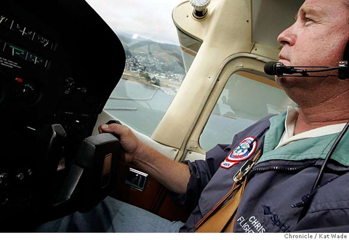 On 6/22/05 Chris Gideon, the owner/operator/pilot of Coastflight one of two Peninsula outfits that charge to take people on scenic tours of the coast and San Francisco in small planes. Gideon flys a four seat Cesna 182 out of the Half Moon Bay Airport. Kat Wade/ The Chronicle
