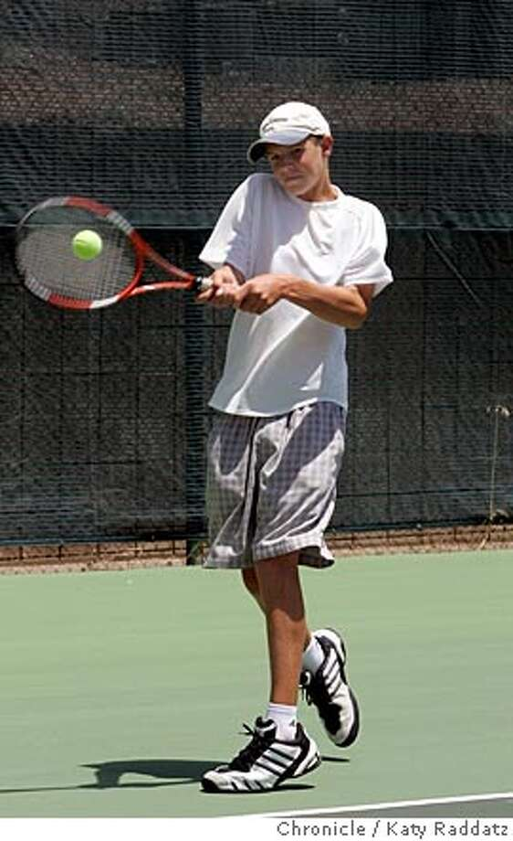 Kid playing tennis in white t shirt is Sky (cq) Lovill, age 14. He's working out at Canon Swim and Tennis Club in Fairfax, CA. Photo taken on 6/26/05, in FAIRFAX, CA.  By Katy Raddatz / The San Francisco Chronicle Photo: Katy Raddatz
