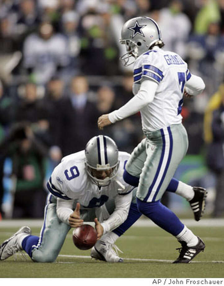 ** CORRECTS TIME TO 1:19 NOT 1:09 ** Dallas Cowboys' Tony Romo, left, bobbles the snap as kicker Martin Gramatica steps in for the kick with 1:19 left in the game against Seattle Seahawks in an NFC wild card playoff football in Seattle, Saturday, Jan. 6, 2007. Gramatica attempted to run the ball but fumbled as he was hit. The Seahawks won, 21-20. (AP Photo/John Froschauer) Photo: John Froschauer