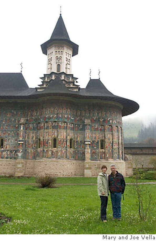 Dec. 24 TRAVEL JUSTBACK -- Mary and Joe Vella before the Sucevita Monastery in northern Romania, near the Ukraine border. 5/7/06 in , . / Special to The Chronicle Photo: Mary And Joe Vella