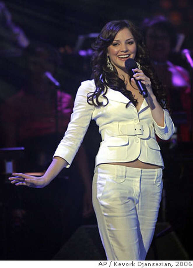 "**FILE** Finalist Katharine McPhee performs during the final show of American Idol in this file photo from May 24, 2006 in Los Angeles. McPhee, who struggled with bulimia for five years, says she's not counting calories on the ""American Idols Live"" tour. ""My diet? Because I'm on tour, it's not very healthy,"" she tells Us Weekly magazine in its latest issue, on newsstands Friday. ""But I'm not controlling (about) my weight anymore, I don't do any weird, disordered eating things anymore, thank God."" (AP Photo/Kevork Djansezian-File) Photo: KEVORK DJANSEZIAN"
