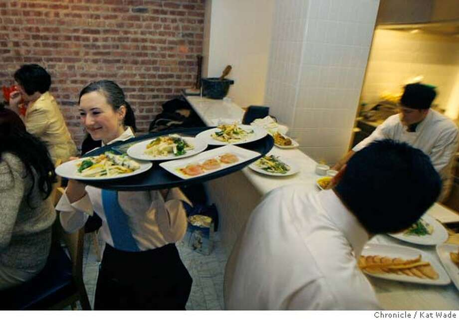 �d.07PERBACCO_0050_KW_.jpg Staff hustles and bustles to serve a full house for dinner at Perbacco, Ristorante and Bar Wednesday evening December 20, 2006 in San Francisco co-owned by chef/owner Staffan (CQ) Terje and owner Umberto Gibin (NOT PICTURED) Kat Wade/The Chronicle Mandatory Credit for San Francisco Chronicle and photographer, Kat Wade, Mags out Photo: Kat Wade