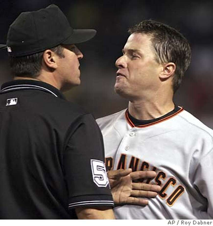 San Francisco Giants J.T. Snow, right, has words with first base umpire Tony Randazzo, after Snow was ejected from the game, Wednesday, June 29, 2005, in Phoenix. Snow hit into a double play, prompting the argument.(AP Photo/Roy Dabner) Photo: ROY DABNER