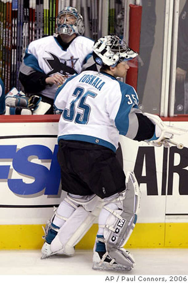 San Jose Sharks goalie Vesa Toskala, front, of Finland, takes the ice in place of Evgeni Nabokov, rear, of Kazakhstan, after the third goal by the Phoenix Coyotes in the first period of a hockey game Saturday, Dec. 30. 2006, in Glendale, Ariz.(AP Photo/Paul Connors) Photo: Paul Connors