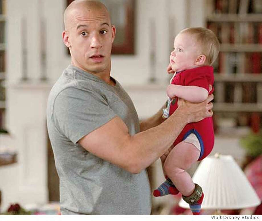 "DVD movie still from the film, ""The Pacifier"" with Vin Diesel. Ran on: 06-28-2005  Vin Diesel gets to mind the kids in comedy &quo;The Pacifier.&quo; Photo: Courtesy Of Disney"