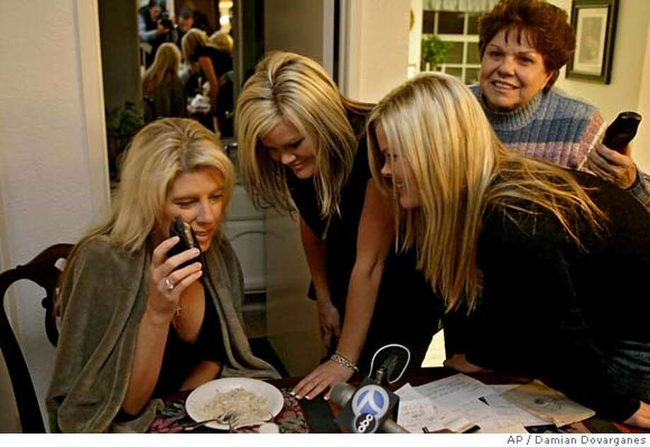 Cathy Chambers, left, along with her boyfriends twin daughters Teryn, center, and Brittney Barnes, second from right, and his mother June Linn, reacts as they get a live phone call from her boyfriend, Ken Barnes Jr., 47, at the family's home in Newport Beach, Calif., Friday, Jan. 5, 2007. Barnes, the American sailor who spent three days adrift on a disabled yacht in treacherous seas off the southern tip of South America, was picked up shortly before 6 a.m. EST Friday by the Chilean trawler Polar Pesca 1, the Chilean navy's Operations Department reported in Punta Arenas, on Chile's southwestern tip. (AP Photo/Damian Dovarganes) Photo: Damian Dovarganes