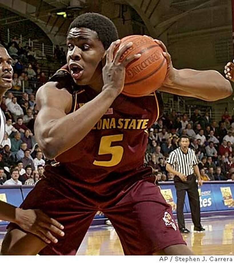 Arizona State's Ike Diogu (5) grabs a rebound in front of Northwestern's Jitim Young, left, during the second half Wednesday, Dec. 17, 2003, in Evanston, Ill. Northwestern won 63-61. (AP Photo/Stephen J. Carrera) Ike Diogu (5) is averaging 24.3 points, 8.8 rebounds and 2.2 blocks a game for Arizona State. Ike Diogu (5) is averaging 24.3 points, 8.8 rebounds and 2.2 blocks a game for Arizona State. Photo: STEPHEN J. CARRERA