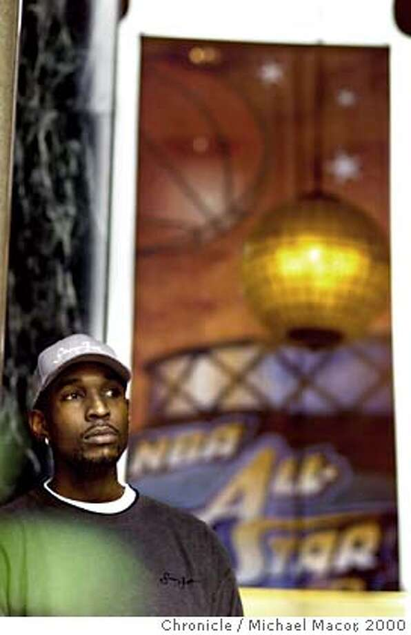NBA ARRIVAL 3-C-11FEB00-SP-MAC NBA players arrive int The St. Francis Hotel in San Francisco for this weekends Allstar Game in Oakland. NBA player Joe Smith of the Tiberwolves waits for a taxi outside the hotel. by Michael Macor/The Chronicle Photo: MICHAEL MACOR
