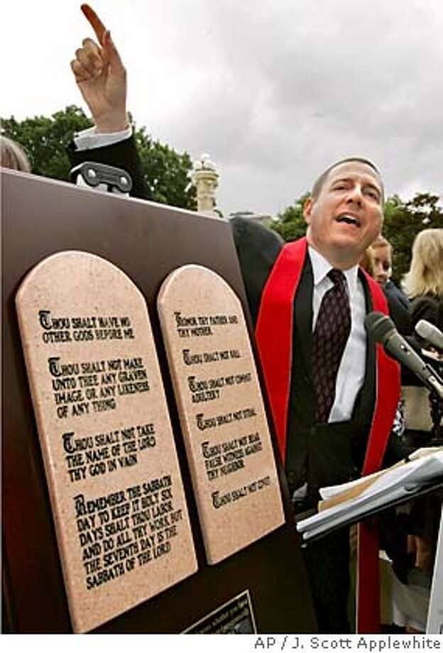 The Rev. Rob Schenck, president of Faith and Action, speaks outside the Supreme Court in Washington as the court struck down the display of the Ten Commandments in two Kentucky courthouses, Monday, June 27, 2005. (AP Photo/J. Scott Applewhite) Photo: J. SCOTT APPLEWHITE