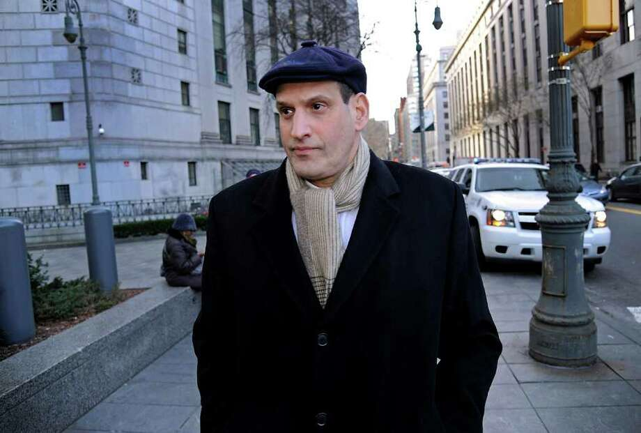 David Slaine, a former Galleon employee who pleaded guilty to insider trading charges, leaves court in New York Friday. He received three years of probation Photo: Peter Foley / © 2012 Bloomberg Finance LP