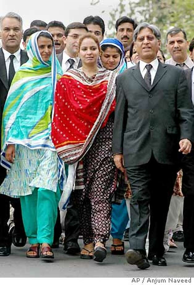 Pakistani rape victim Mukhtar Mai, left, accompanied by her lawyer Aitzaz Ahsan, right, and her supporter Nargis Faiz Malik, center, leaves from Supreme Court after the court decision, Tuesday, June 28, 2005 in Islamabad, Pakistan. Pakistan's Supreme Court overturned the acquittals of 13 suspects in the gang rape of Mai, whose plight drew international attention, and ordered them re-arrested, court officials and a lawyer in the case said. (AP Photo/Anjum Naveed) Ran on: 06-29-2005  Mukhtaran Bibi (left), supporter Nargis Faiz Malik (center) and lawyer Aitzaz Ahsan leave the Supreme Court in Islamabad. Ran on: 06-29-2005  Mukhtaran Bibi (left), supporter Nargis Faiz Malik (center) and lawyer Aitzaz Ahsan leave the Supreme Court in Islamabad. Ran on: 06-29-2005  Mukhtaran Bibi (left), supporter Nargis Faiz Malik (center) and lawyer Aitzaz Ahsan leave the Supreme Court in Islamabad. Photo: ANJUM NAVEED