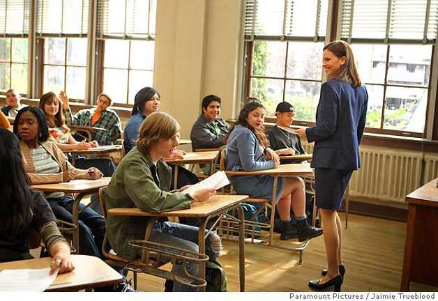 "�Hilary Swank (right) as Erin Gruwell in ""Freedom Writers,"" Paramount Pictures Presents In Association with MTV Films, a Jersey Films/Double Feature Films Production, ""Freedom Writers."" Directed by Richard LaGravenese from a screenplay from Richard LaGravenese, based on the book ""The Freedom Writers Diary"" by the Freedom Writers with Erin Gruwell, the film is produced by Danny DeVito, Michael Shamberg, and Stacey Sher. Executive producers are Hilary Swank, Tracey Durning, Nan Morales, and Dan Levine. Photo credit: Jaimie Trueblood"