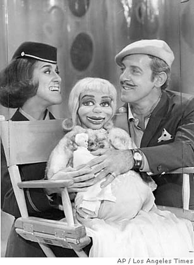 """Paul Winchell, right, and Ruth Buzzi are seen on the set of the television show """"Rowan and Martin's Laugh-in,"""" in this 1969 photo. Winchell, a ventriloquist, inventor and children's TV show host best known for creating the lispy voice of Winnie the Pooh's animated friend Tigger, died Friday, June 24, 2005 at his home in Moorpark, Calif. He was 82. (AP Photo/Los Angeles Times) ** MANDATORY CREDIT ** NO MAGS, , NO FOREIGN, LA DAILY NEWS, OC REGISTER, SAN BERNADINO SUN, VENTRA STAR OUT NO MAGS, , NO FOREIGN, LA DAILY NEWS, OC REGISTER, SAN BERNADINO SUN, VENTRA STAR OUT, MANDATORY CREDIT Ran on: 06-27-2005  Paul Winchell (right) and Ruth Buzzi share a moment on the set of the television show &quo;Rowan & Martin's Laugh-in&quo; in 1969."""