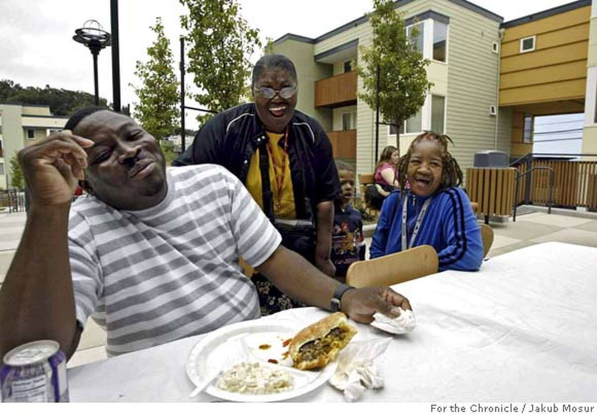 Housing27_08_JMM.JPG From left to right, Lemar Rash, Anne Waters and Florence Allen chat during a barbecue at the Carter Terrace, a new affordable housing complex in Visitacion Valley on Saturday June 25, 2005. Event on 6/25/05 in San Francisco. JAKUB MOSUR / The Chronicle MANDATORY CREDIT FOR PHOTOG AND SF CHRONICLE/ -MAGS OUT