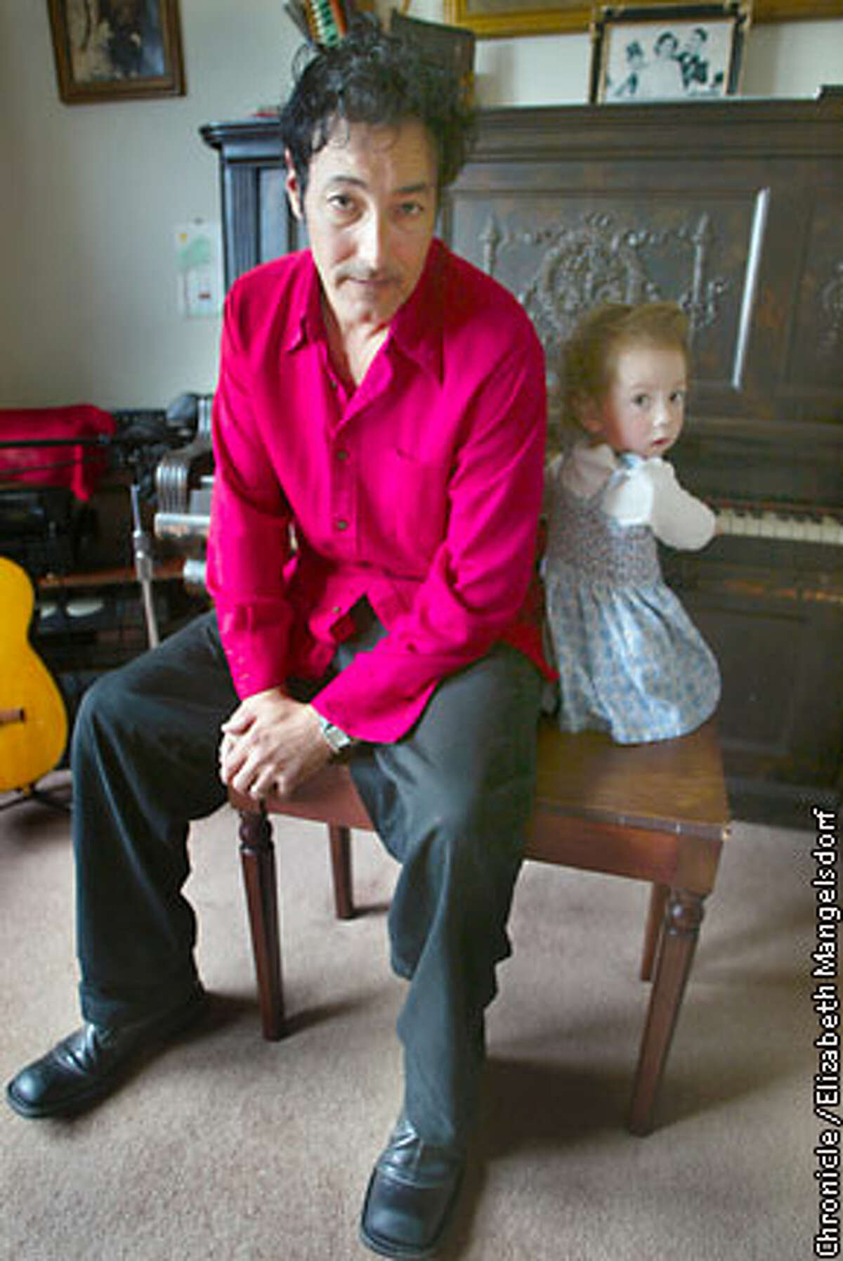 Songwriter Jesse DeNatale and his 2-year-old daughter Lucinda in their San Francisco living room. Chronicle photo by Elizabeth Mangelsdorf