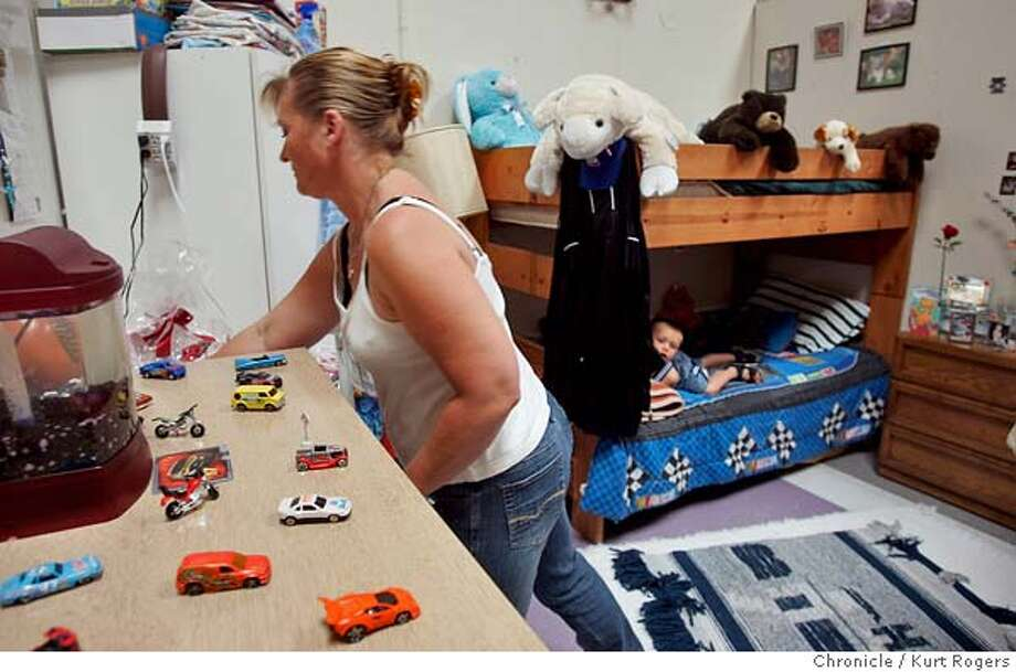 Cindy Schmidt and her son Anthony Mendivil 3 are living in the North Concord Family Emergency Shelter they are in the room thay they share.  A coalition of housing advocates and nonprofit homeless service providers are launching a community fundraising campaign to keep two family shelters open in contra costa county.  SHELTER30_0008_kr.JPG 6/29/05 in CONCORD,CA.  KURT ROGERS/THE CHRONICLE MANDATORY CREDIT FOR PHOTOG AND SF CHRONICLE/ -MAGS OUT Photo: KURT ROGERS