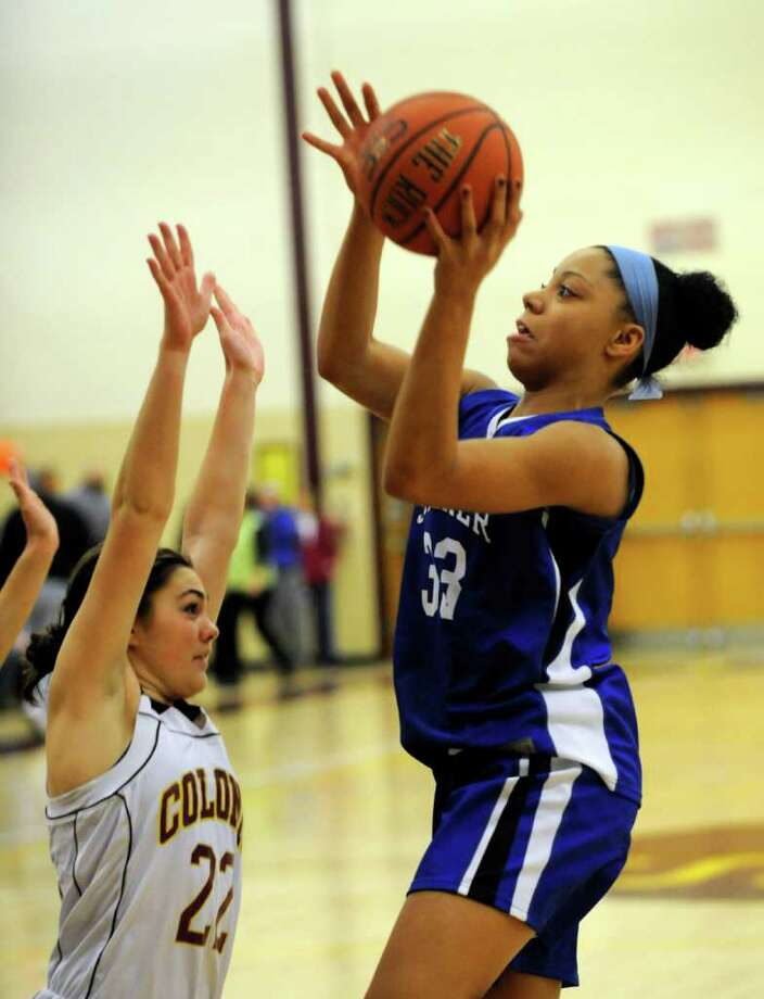 Colonie's Laura Kipper (22) defends against Shaker's Mackenzie Rowland (33) during their High School Basketball game in Colonie, N.Y., Friday, Jan. 20, 2012. (Hans Pennink / Special to the Times Union) High School Sports Photo: Hans Pennink / Hans Pennink