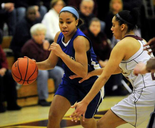 Shaker's Madison Rowland ,left, moves the ball against Colonie's Sydnie Rosales during their High Sc