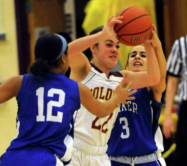 Shaker's Madison Rowland (12) and teammate Erica Vallecorsa (3) defend against against Colonie's Lau