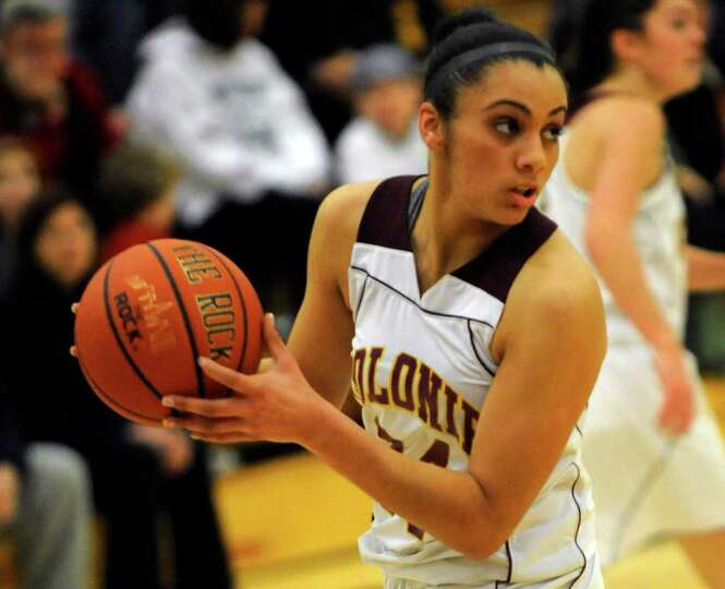 Colonie's Sydnie Rosales (24) moves the ball against Shaker during their High School Basketball game
