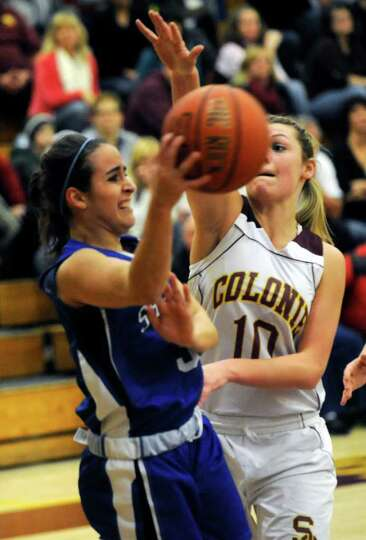 Shaker's Erica Vallecorsa ,left, is defended by Colonie's Jaclyn Welch during their High School Bask